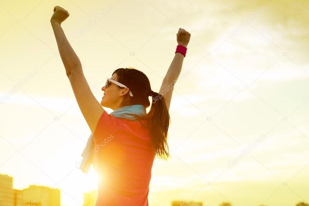 depositphotos_23477727-stock-photo-sportswoman-with-arms-up-celebrating